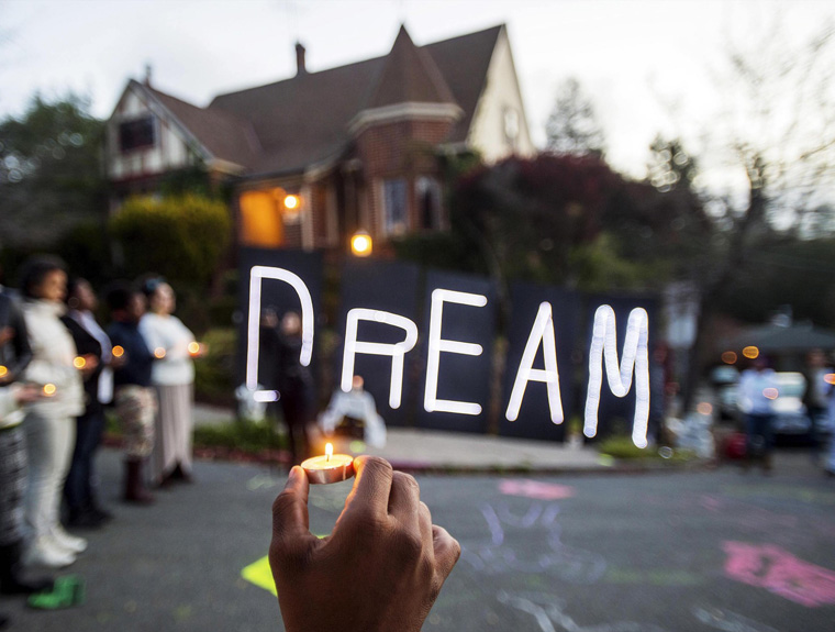 "Black rights protesters gather near illuminated letters spelling ""DREAM"" outside a house which they identified as the residence of Oakland Mayor Libby Schaaf, in Oakland"