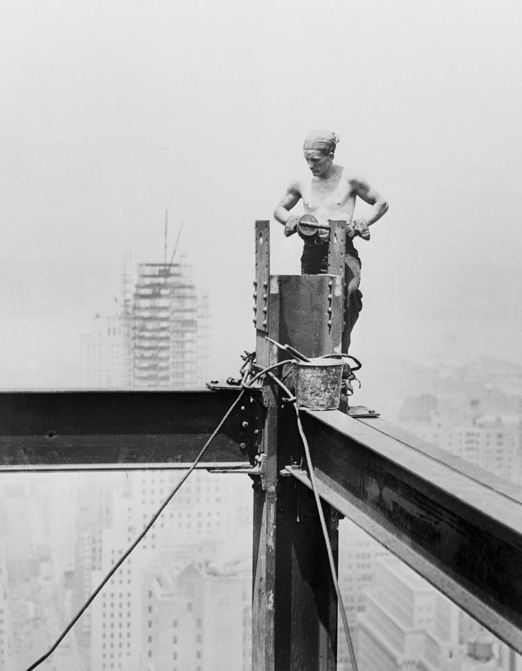 Steel Worker Arranging Steel Frame