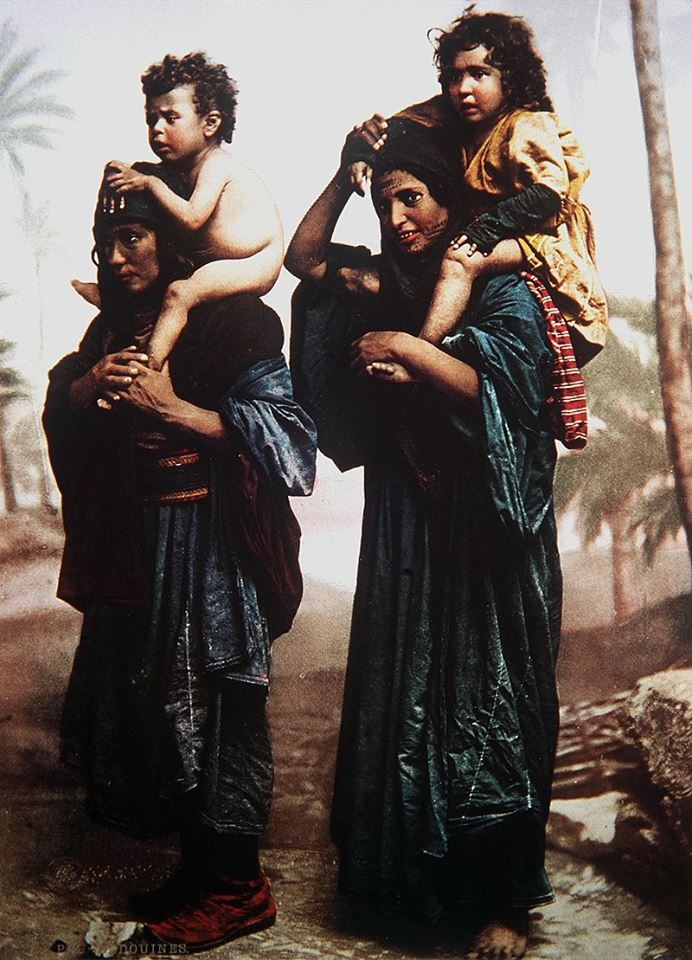 bedouin-mothers-carrying-their-children-on-their-shoulders-color-photo-taken-in-the-late-19th-century-by-the-french-photographer-felix-bonfils